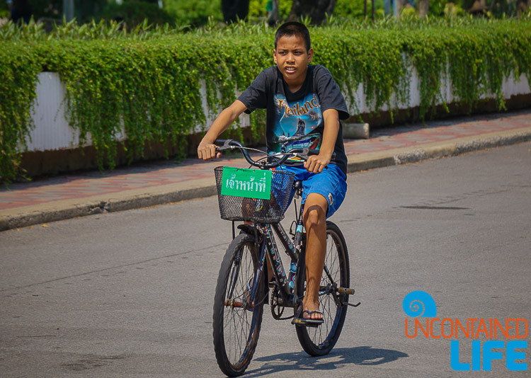 Boy on bike in Lumpini Park Bangkok