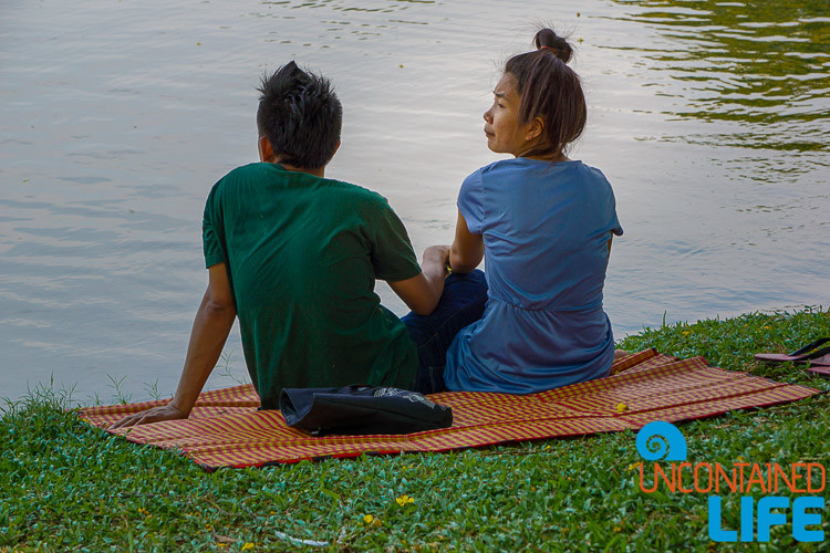 Couple by lake in Lumpini Park Bangkok