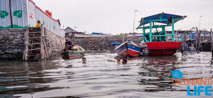 Children Swimming in Jakarta Slums, Uncontained Life